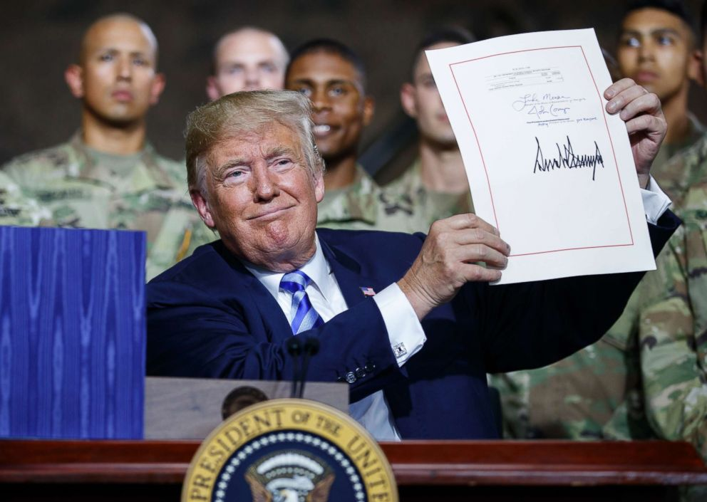 PHOTO: President Donald Trump during a signing ceremony for a $716 billion defense policy bill named for Sen. John McCain, Aug. 13, 2018, in Fort Drum, N.Y.