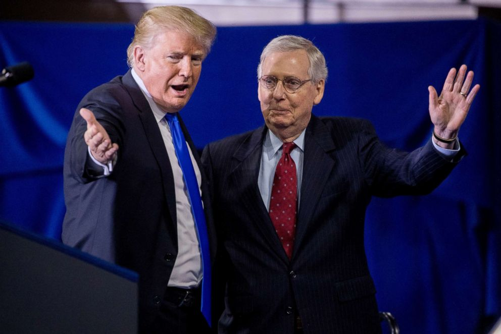 PHOTO: President Donald Trump invites Senate Majority Leader Mitch McConnell, right, onstage as he speaks at a rally at Alumni Coliseum in Richmond, Ky., Oct. 13, 2018.