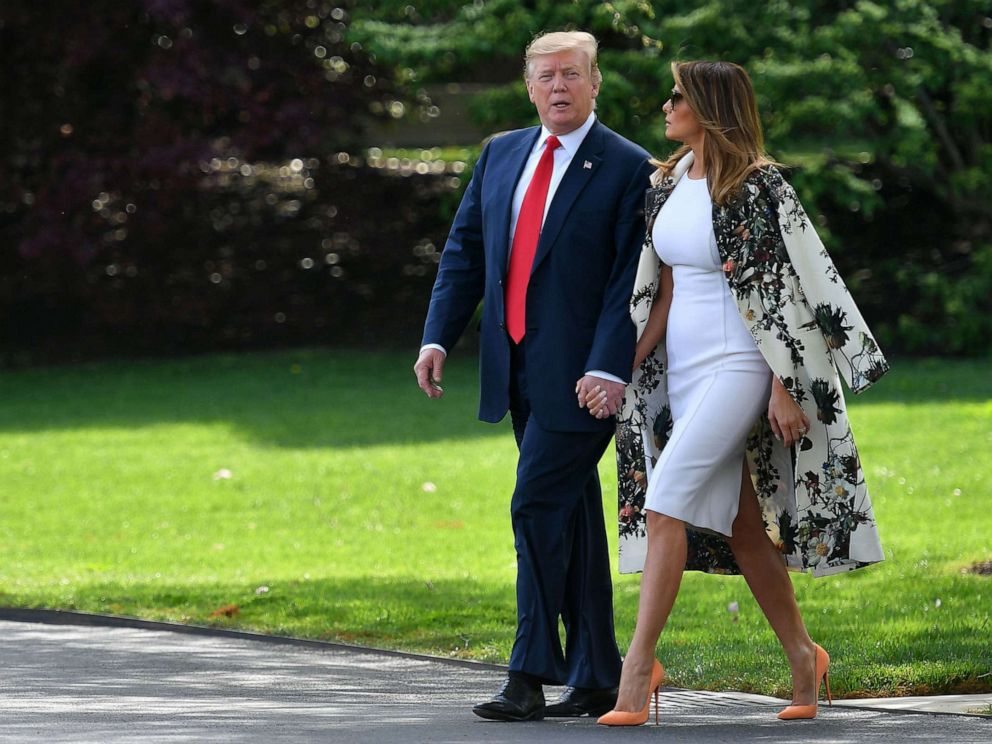 PHOTO: President Donald Trump and first lady Melania Trump walk together to board Marine One from the South Lawn of the White House in Washington, D.C., on April 18, 2019.