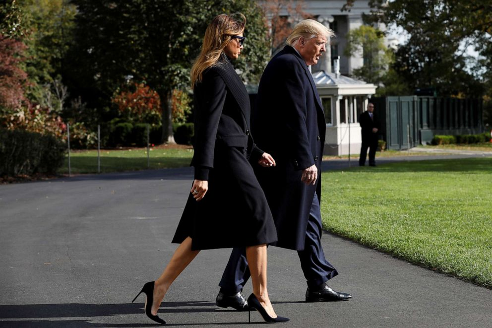 PHOTO: President Donald Trump and first lady Melania Trump walk across the South Lawn of the White House, Nov. 9, 2019.
