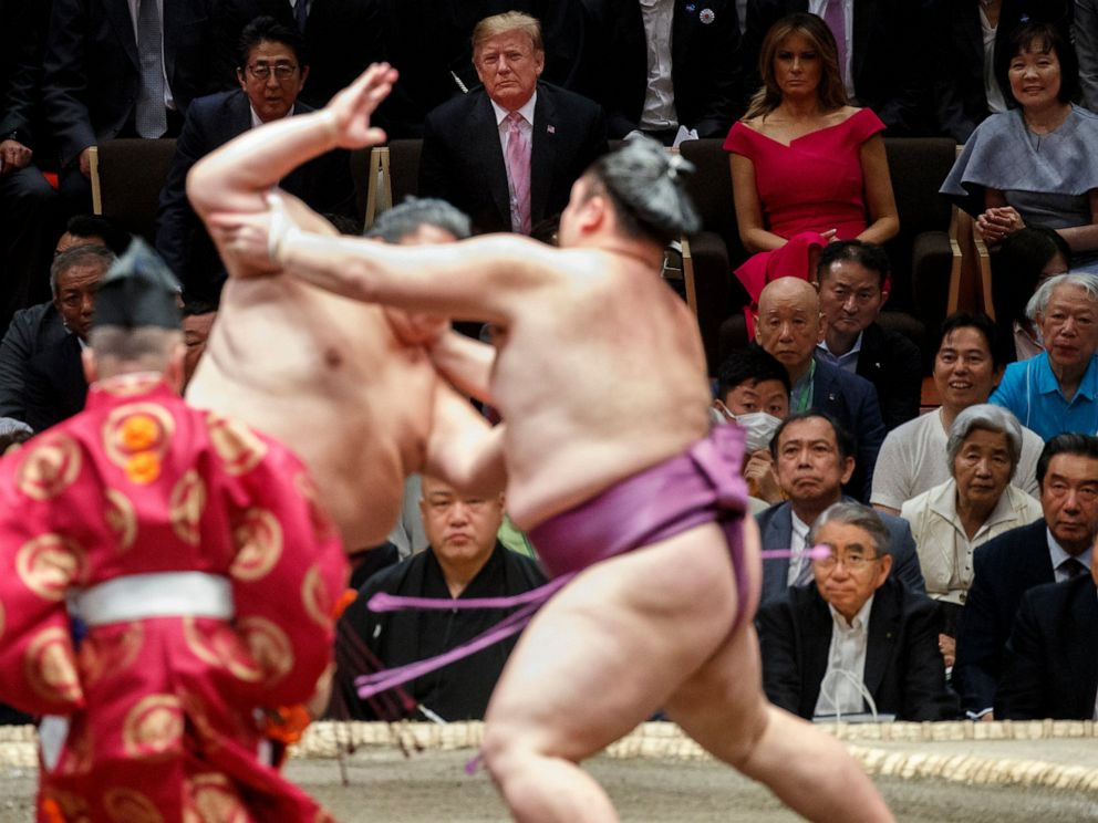 PHOTO: President Donald Trump attends the Tokyo Grand Sumo Tournament with Japanese Prime Minister Shinzo Abe at Ryogoku Kokugikan Stadium, Sunday, May 26, 2019, in Tokyo. At top right is Akie Abe and second from right is first lady Melania Trump.