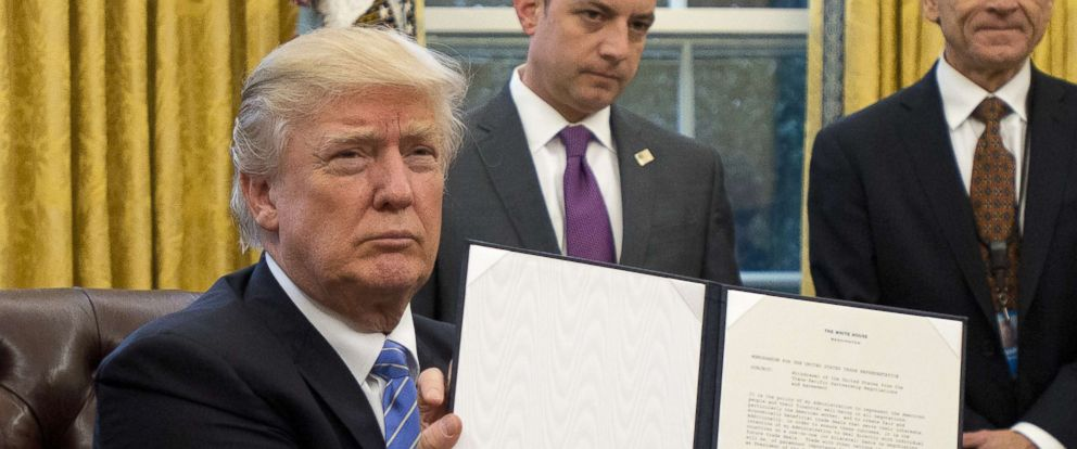 "PHOTO: President Donald Trump holds an executive order titled ""Mexico City Policy"", which bans federal funds going to overseas organizations that perform abortions, Jan. 23, 2017."