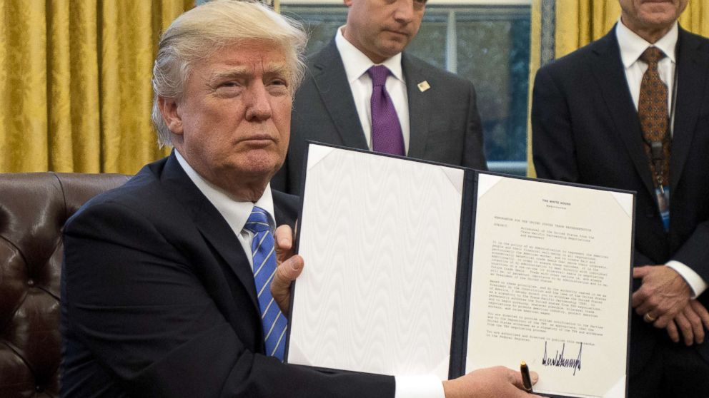 "President Donald Trump holds an executive order titled ""Mexico City Policy"", which bans federal funds going to overseas organizations that perform abortions, Jan. 23, 2017."