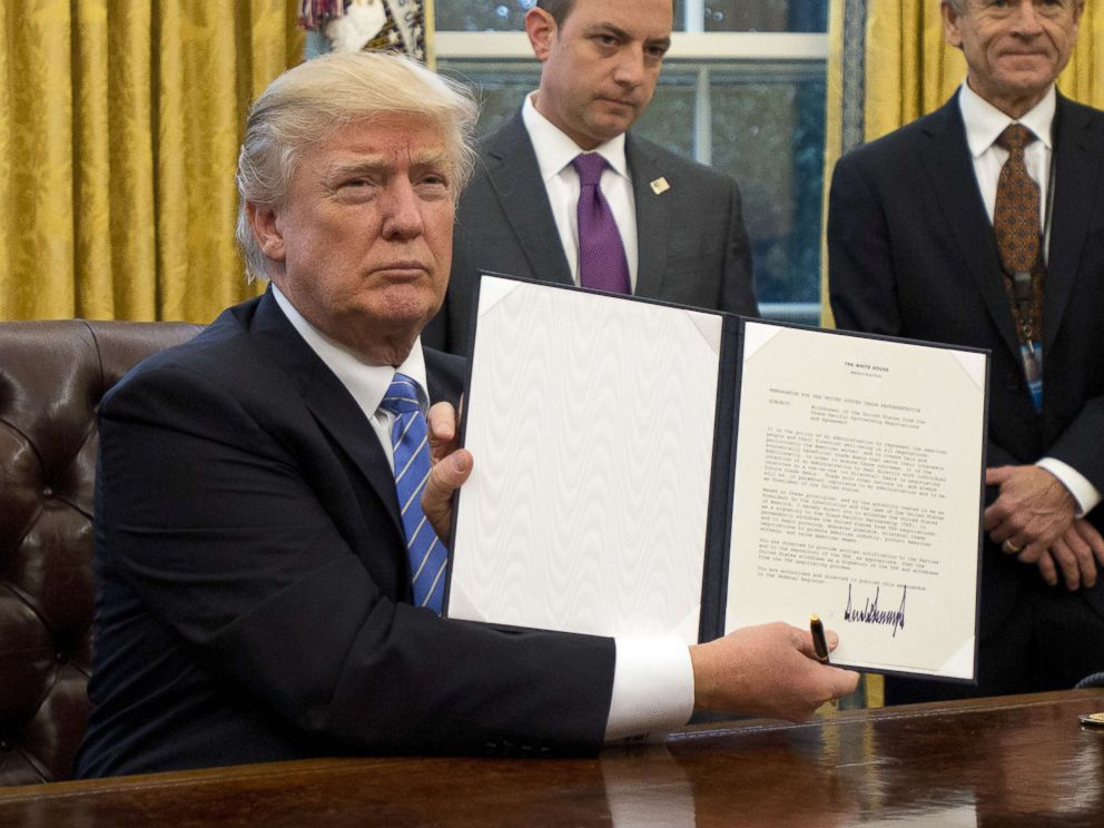 PHOTO: President Donald Trump holds an executive order titled Mexico City Policy, which bans federal funds going to overseas organizations that perform abortions, Jan. 23, 2017.