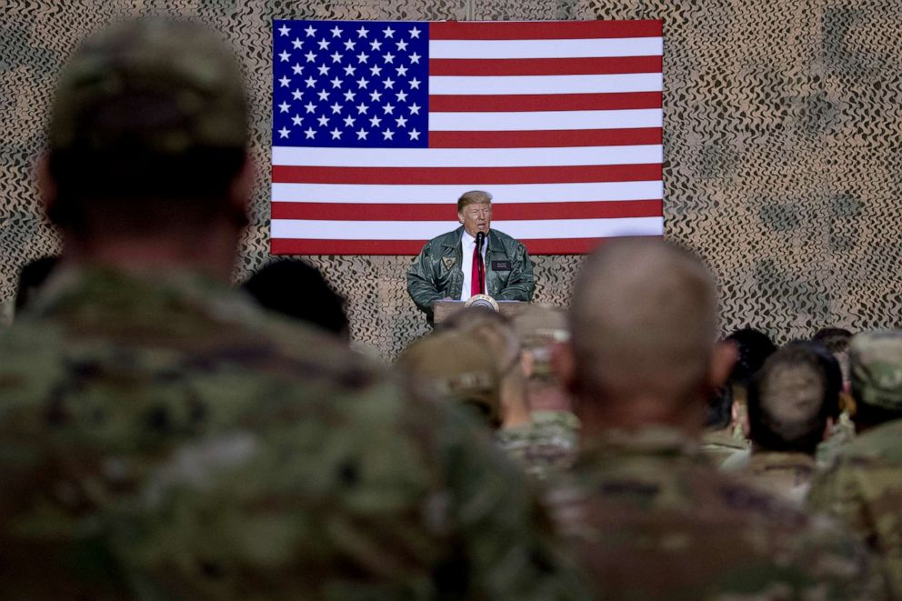 PHOTO: In this file photo, President Donald Trump speaks to members of the military at a hangar rally at Al Asad Air Base, Iraq, on Dec. 26, 2018.