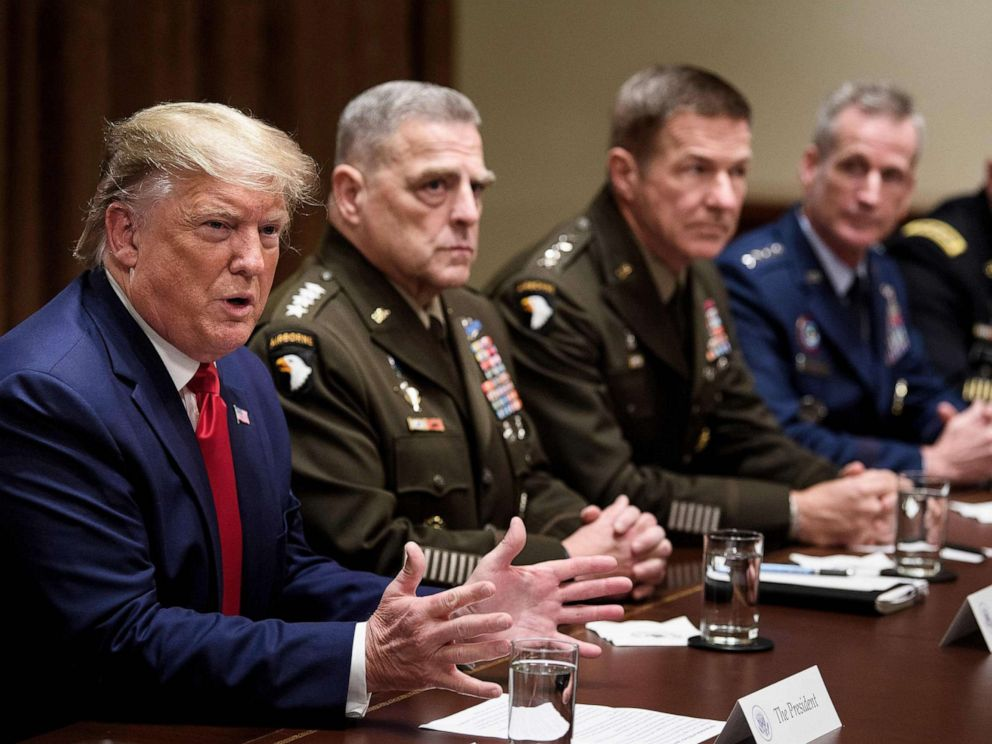PHOTO: President Donald Trump speaks during a meeting with senior military leaders including Chairman of the Joint Chiefs of Staff Army General Mark A. Milley, seated next to Trump, in the Cabinet Room of the White House Oct. 7, 2019.