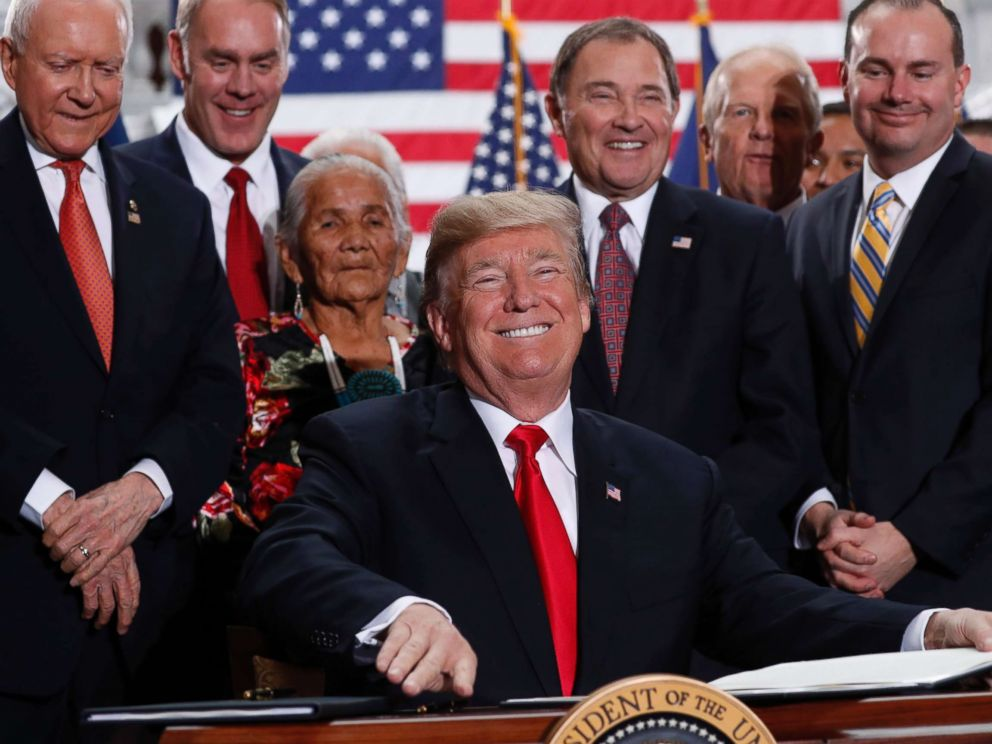 PHOTO: President Donald Trump smiles upon signing an executive order after announcing big cuts to Utahs sprawling wilderness national monuments at the Utah State Capitol in Salt Lake City, Dec. 4, 2017.
