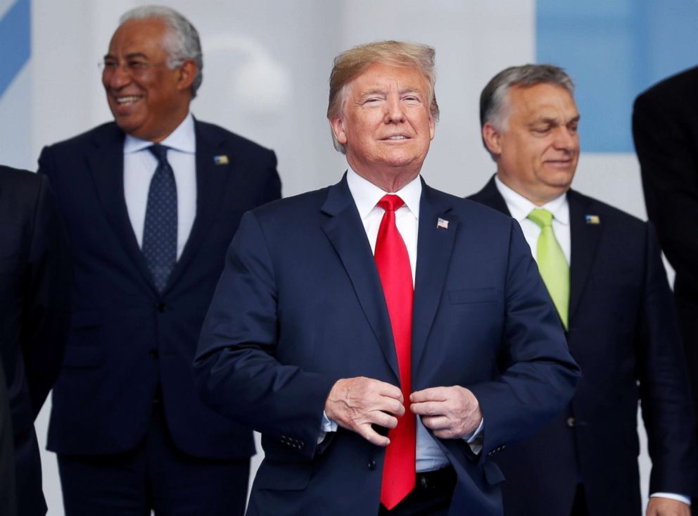 President Donald Trump reacts as he poses for a family photo at the start of the NATO summit in Brussels, July 11, 2018.