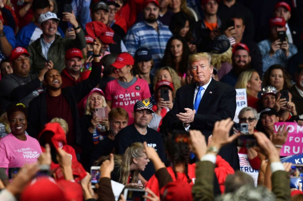 PHOTO: President Donald Trump claps during a Make America Great Again rally at Bojangles Coliseum, Oct. 26, 2018, in Charlotte, North Carolina.