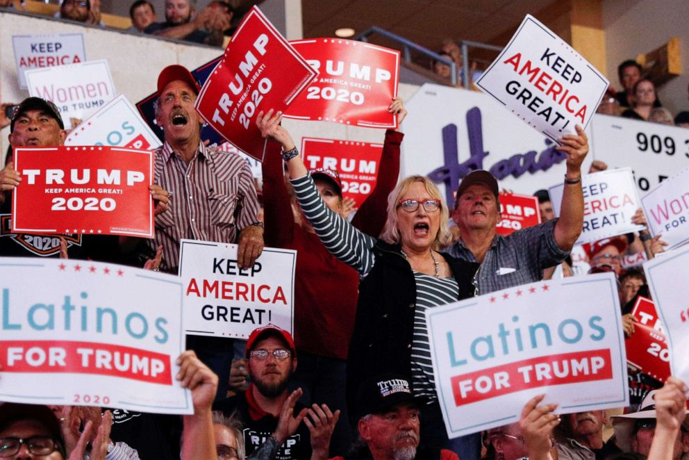 PHOTO: Members of the audience look on as President Donald Trump delivers remarks at a Keep America Great rally at the Santa Ana Star Center in Rio Rancho, New Mexico, on Monday, Sept. 16, 2019.