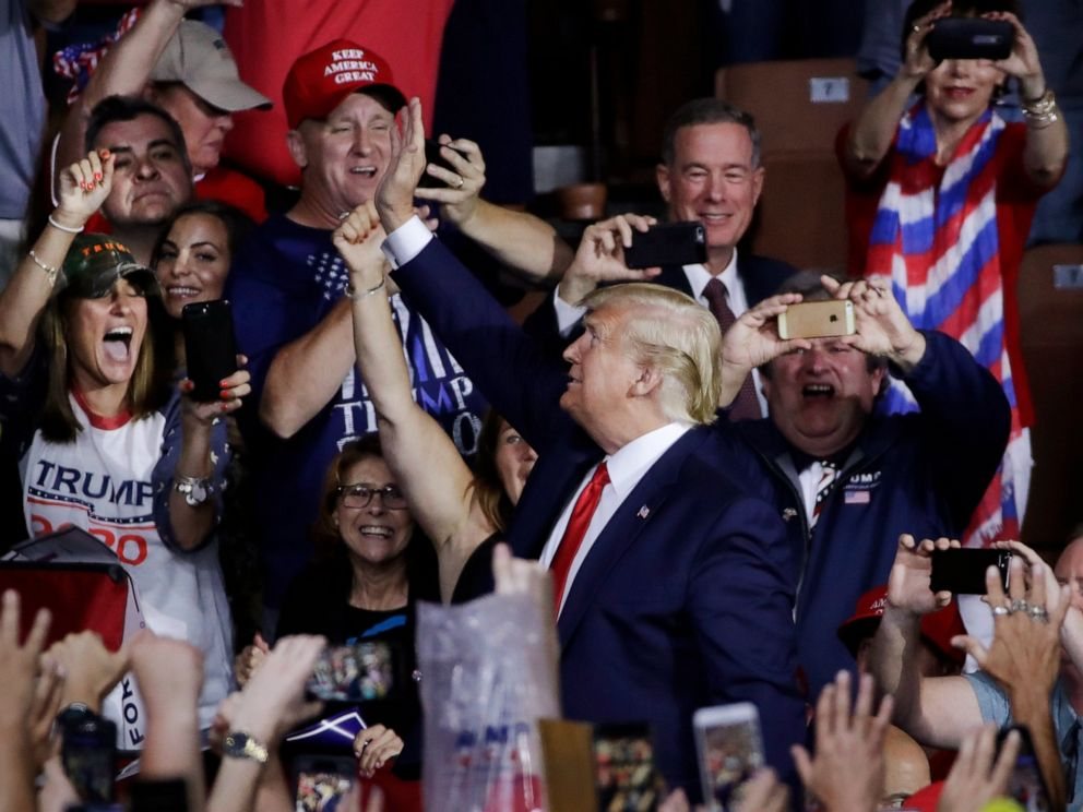 PHOTO: Supporters cheer as President Donald Trump arrives to a campaign rally, Thursday, Aug. 15, 2019, in Manchester, N.H.