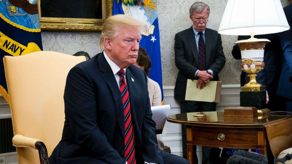 President Donald Trump's while meeting with President Moon Jae-in of South Korea in the Oval Office of the White House, May 22, 2018. In the background is National Security Adviser John Bolton.