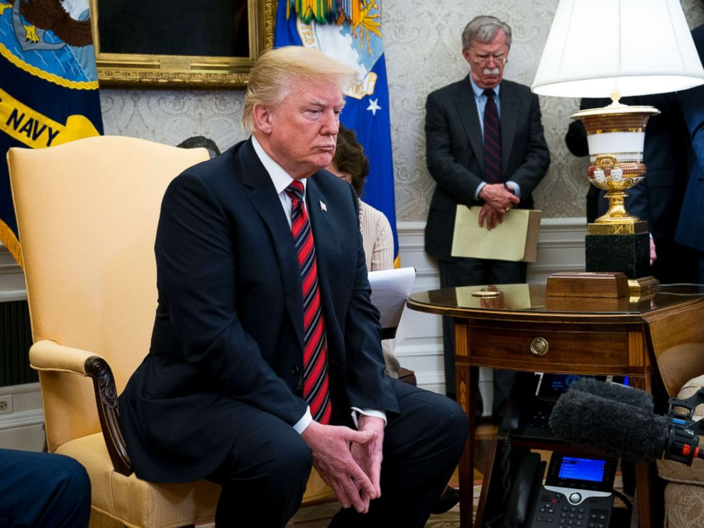 PHOTO: President Donald Trumps while meeting with President Moon Jae-in of South Korea in the Oval Office of the White House, May 22, 2018. In the background is National Security Adviser John Bolton.