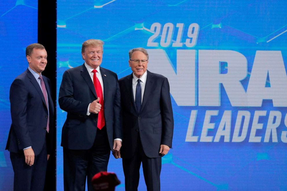 PHOTO: President Donald Trump is greeted by Chris Cox, left, and Wayne LaPierre, right, executive vice president and CEO of the National Rifle Association (NRA) at the NRA annual meeting in Indianapolis, Indiana, April 26, 2019.