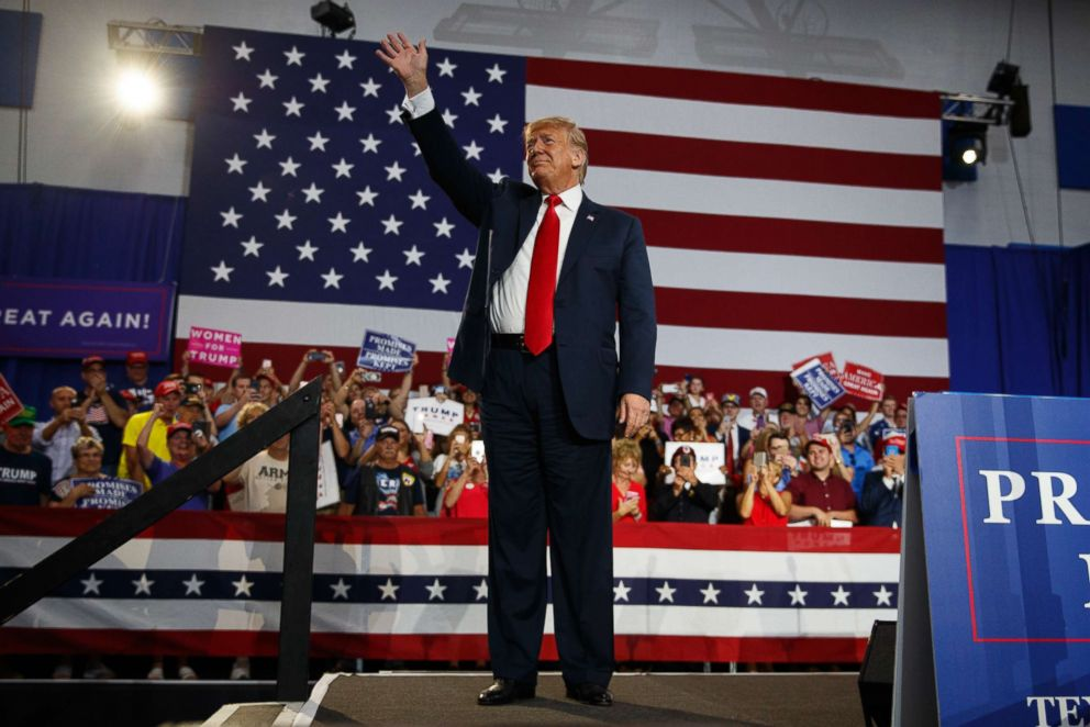 PHOTO: President Donald Trump waves to the cheering crowd as he arrives to speak at a rally at Olentangy Orange High School in Lewis Center, Ohio, August 4, 2018.