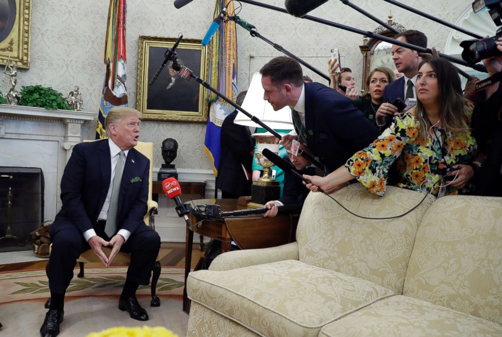 President Donald Trump talks to the press during a meeting in the Oval Office of the White House, March 14, 2019.