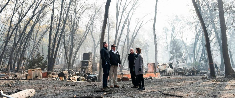 PHOTO: President Donald Trump looks on with Paradise Mayor Jody Jones, Governor of California Jerry Brown, and Lieutenant Governor of California, Gavin Newsom, as they view damage from wildfires in Paradise, Calif., Nov. 17, 2018.