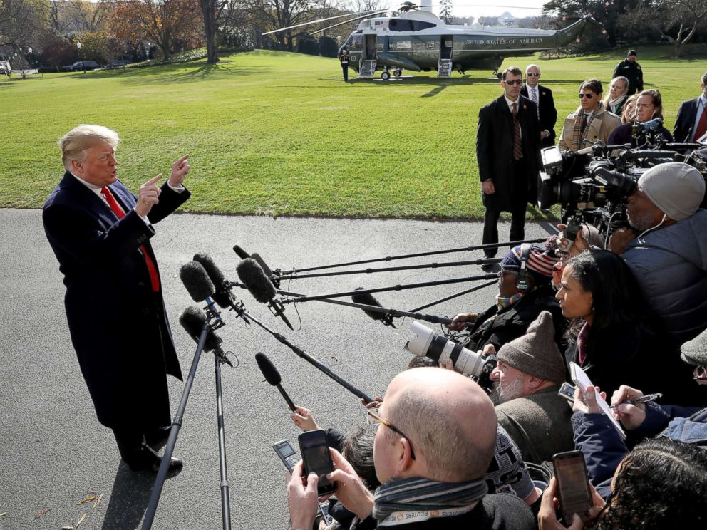 PHOTO: President Donald Trump answers questions from the press while departing the White House, Nov. 29, 2018 in Washington.