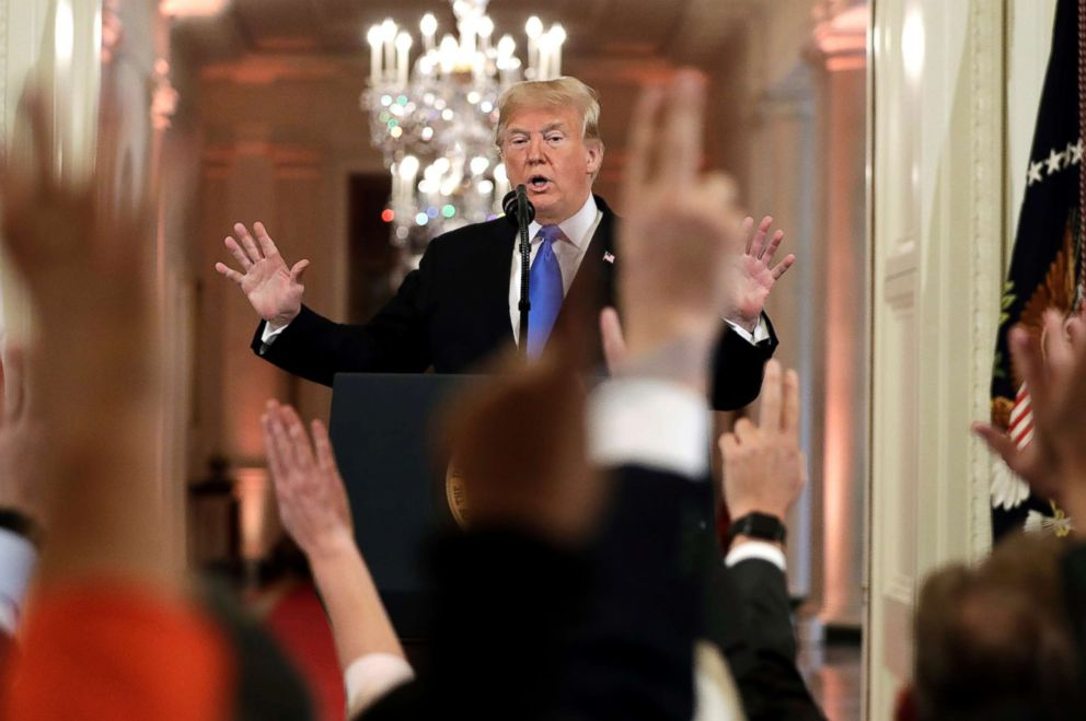 President Donald Trump reacts as reporters raise their hands to ask questions during a news conference in the East Room of the White House, Nov. 7, 2018.