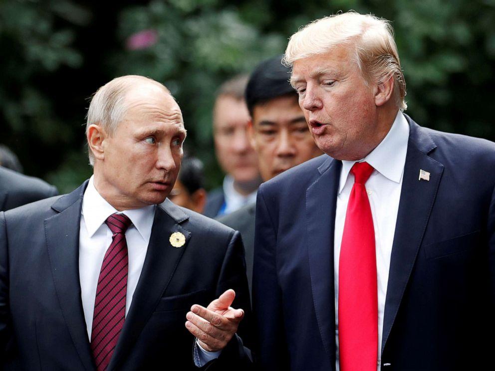 PHOTO: U.S. President Donald Trump and Russias President Vladimir Putin talk during the family photo session at the APEC Summit in Danang, Vietnam, November 11, 2017.