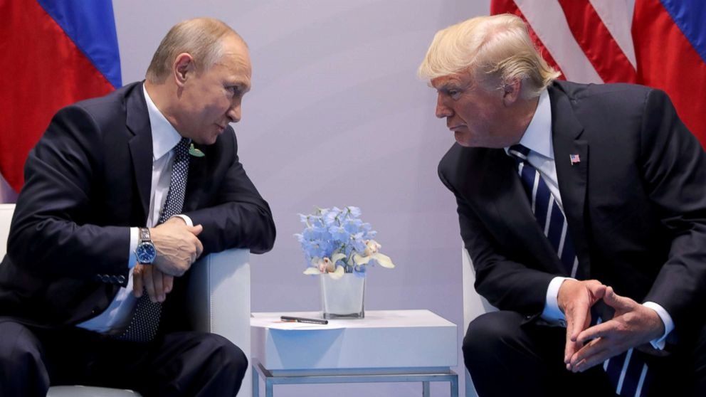 FILE PHOTO: Russia's President Vladimir Putin talks to U.S. President Donald Trump during their bilateral meeting at the G20 summit in Hamburg, Germany, July 7, 2017.