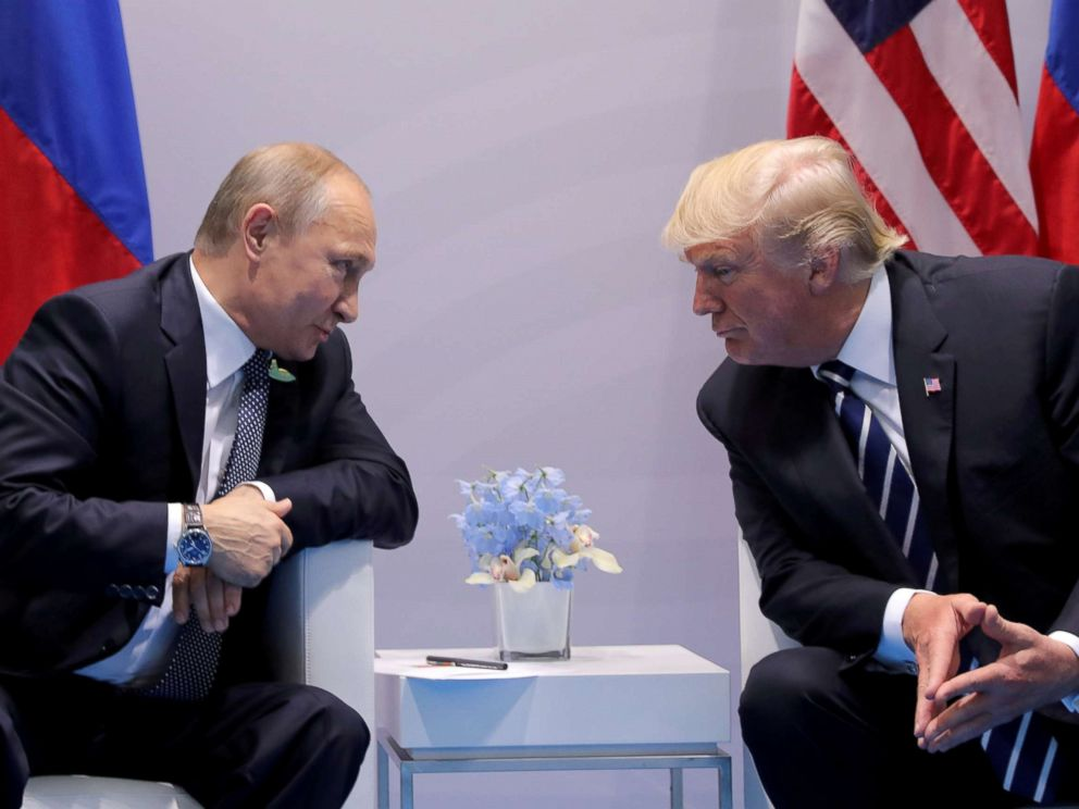 PHOTO: FILE PHOTO: Russias President Vladimir Putin talks to U.S. President Donald Trump during their bilateral meeting at the G20 summit in Hamburg, Germany, July 7, 2017.