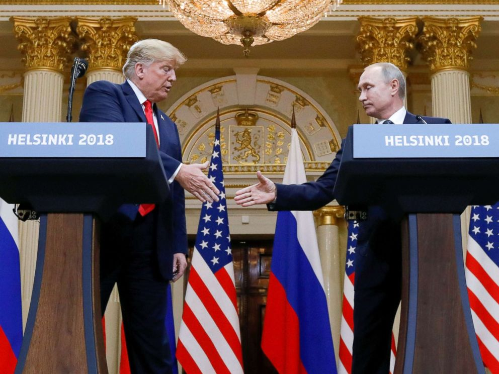 PHOTO: President Donald Trump and Russias President Vladimir Putin shake hands during a joint news conference after their meeting in Helsinki, Finland, July 16, 2018.