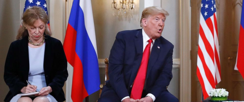 PHOTO: Interpreter Marina Gross, left, takes notes when President Donald Trump talks to Russian President Vladimir Putin at the beginning of their one-on-one-meeting at the Presidential Palace in Helsinki, Finland, July 16, 2018.