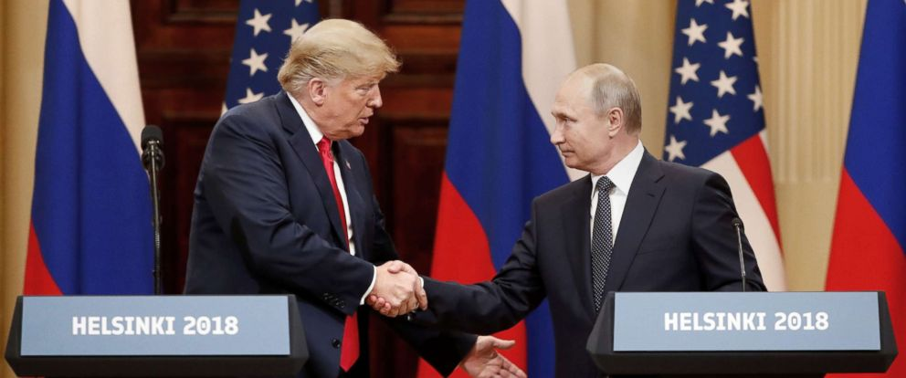 PHOTO: President Donald Trump and Russian President Vladimir Putin shake hands as they hold a joint news conference after their meeting in Helsinki, Finland July 16, 2018.