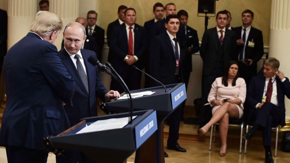 """President Donald Trump and Russia's President Vladimir Putin shake hands during a joint press conference after a meeting at the Presidential Palace in Helsinki, Finland, July 16, 2018.Russian President Vladimir Putin said that there were no """"objective reasons"""" for tensions in US-Russia ties, speaking after several hours of talks with US leader Donald Trump. / AFP PHOTO / Brendan SMIALOWSKIBRENDAN SMIALOWSKI/AFP/Getty Images"""