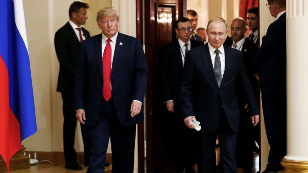 President Donald Trump and Russia's President Vladimir Putin arrive to hold a joint news conference after their meeting in Helsinki, July 16, 2018.