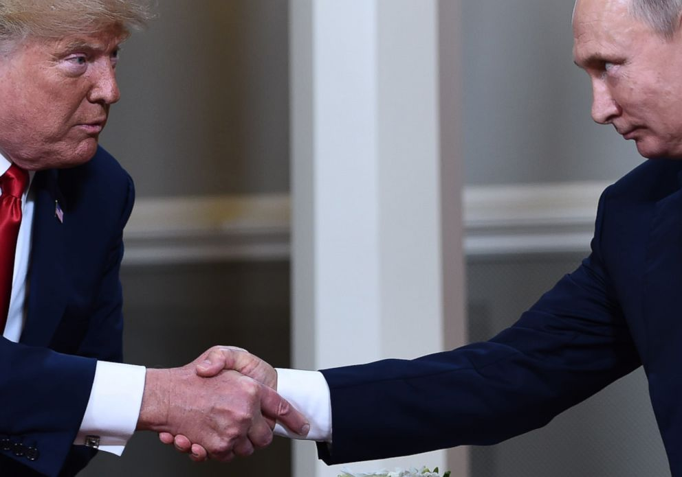 PHOTO: President Donald Trump and Russian President Vladimir Putin shake hands ahead a meeting in Helsinki, July 16, 2018.