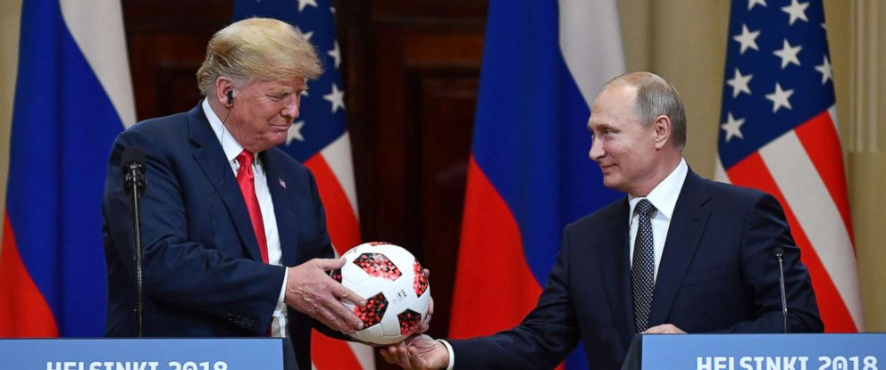 PHOTO: Russias President Vladimir Putin offers a ball of the 2018 football World Cup to President Donald Trump during a joint press conference after a meeting at the Presidential Palace in Helsinki, Finland, July 16, 2018.