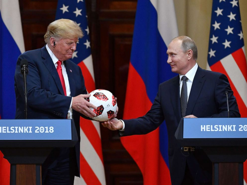 driving  street PHOTO: Russias President Vladimir Putin offers a ball of the 2018 football World Cup to President Donald Trump during a joint press conference after a meeting at the Presidential Palace in Helsinki, Finland, July 16, 2018.