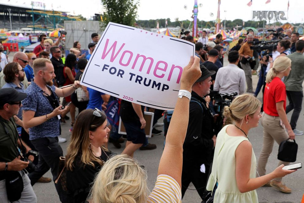 PHOTO: A fairgoer holds up a Women for Trump at the Iowa State Fair, Aug. 11, 2019, in Des Moines, Iowa.