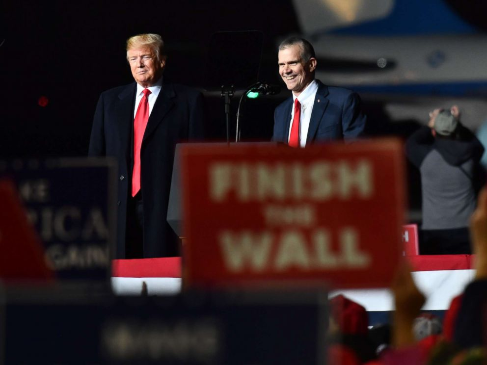 PHOTO: President Donald Trump and Matt Rosendale (R), Republican Auditor and candidate for the US Senate speaks during a Make America Great rally in Missoula, Mont., Oct. 18, 2018.