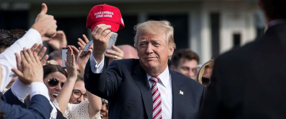 PHOTO: President Donald Trump holds up a Make America Great Again hat while greeting onlookers on the South Lawn of the White House, Sept. 29, 2017, in Washington.