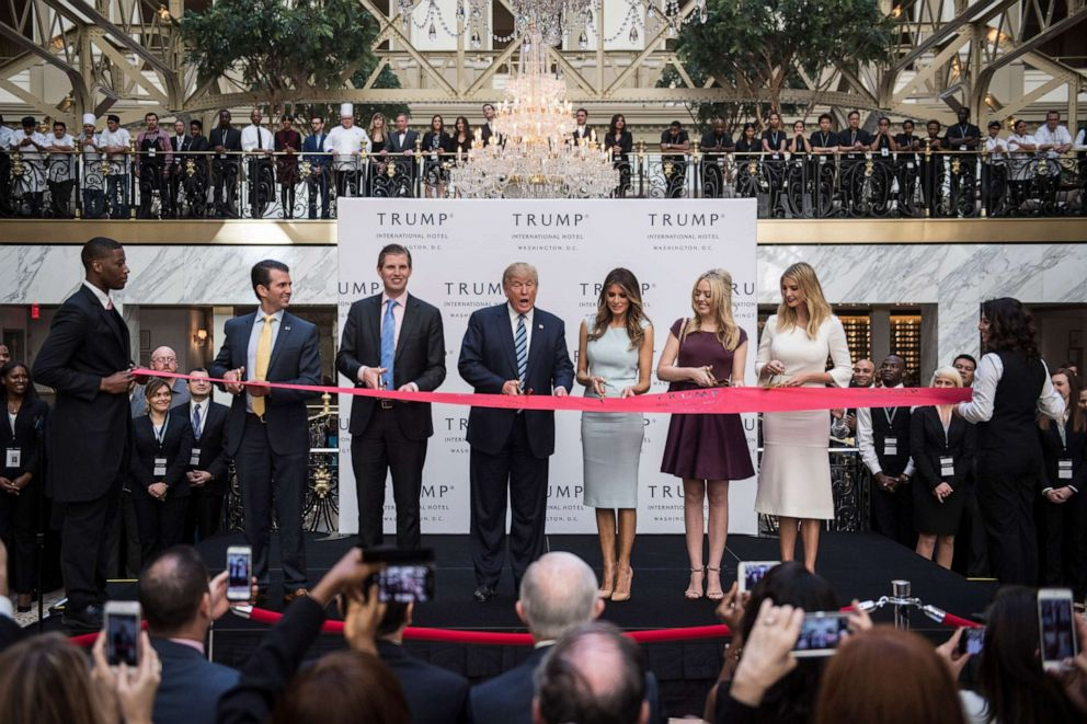 PHOTO: Donald Trump, accompanied by, from left, Donald Trump Jr., Eric Trump, Trump, Tiffany Trump, Melania Trump, and Ivanka Trump, cut a ribbon during the grand opening ceremony of the Trump International Hotel in Washington, D.C., Oct. 26, 2016.