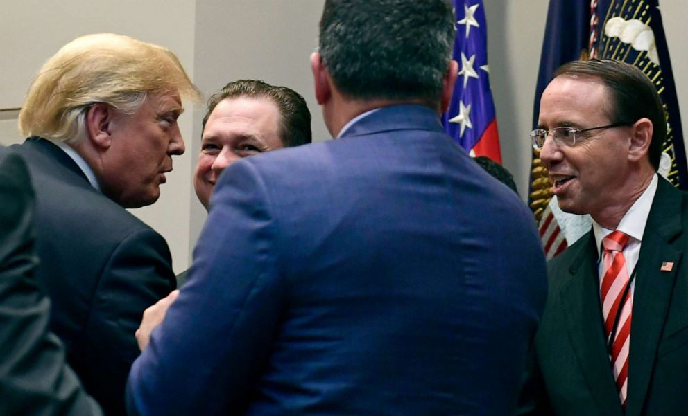 PHOTO: President Donald Trump, left, shakes hands with Deputy Attorney General Rod Rosenstein, right, following a signing ceremony in the Roosevelt Room of the White House in Washington, Oct. 10, 2018.