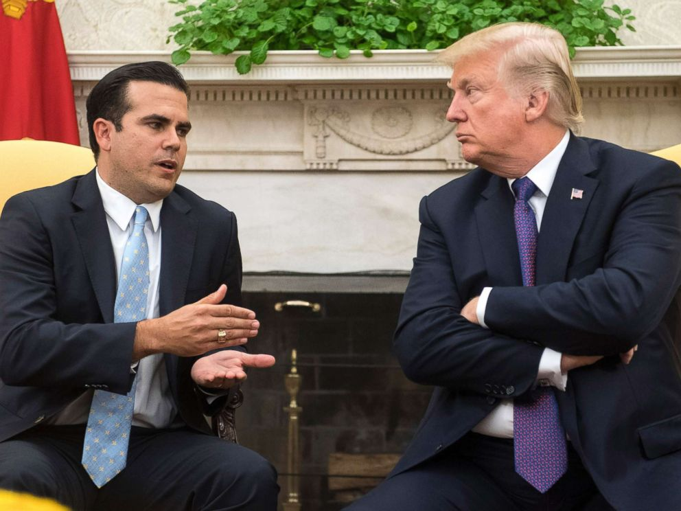 PHOTO: President Donald Trump listens as Governor Ricardo Rossello of Puerto Rico speaks during a meeting in the Oval Office at the White House on Oct. 19, 2017 in Washington, D.C.