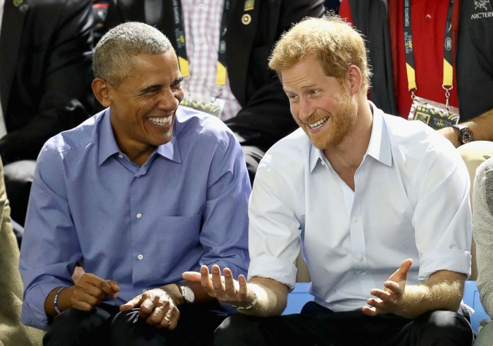 PHOTO: Former President Barack Obama and Prince Harry share a joke as they watch wheelchair basketball on day 7 of the Invictus Games 2017 on September 29, 2017 in Toronto, Canada.