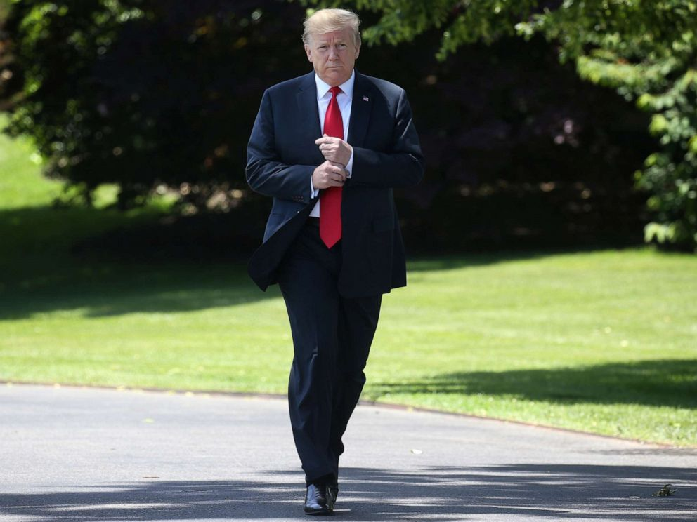 PHOTO: President Donald Trump leaves the Oval Office to speak to the news media before boarding Marine One from the South Lawn of the White House, May 24, 2019.