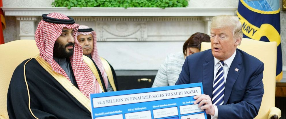 PHOTO: In this file photo, President Donald Trump holds a defense sales chart with Saudi Arabias Crown Prince Mohammed bin Salman in the Oval Office of the White House on March 20, 2018, in Washington.