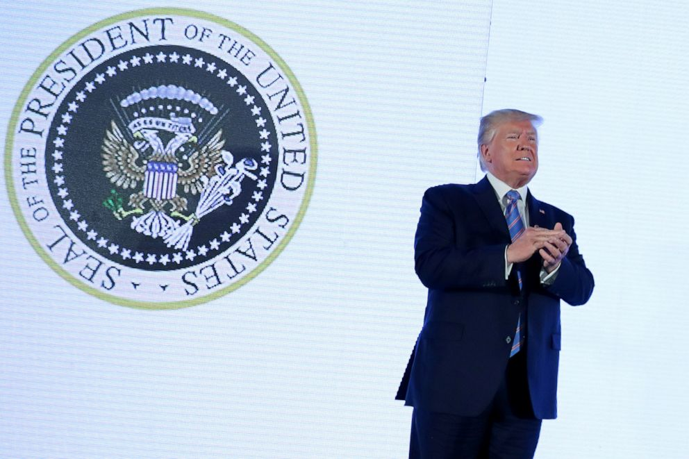 PHOTO: U.S. President Donald Trump takes the stage next to an altered presidential seal prior to a speech at Turning Point USAs Teen Student Action Summit in Washington, July 23, 2019.