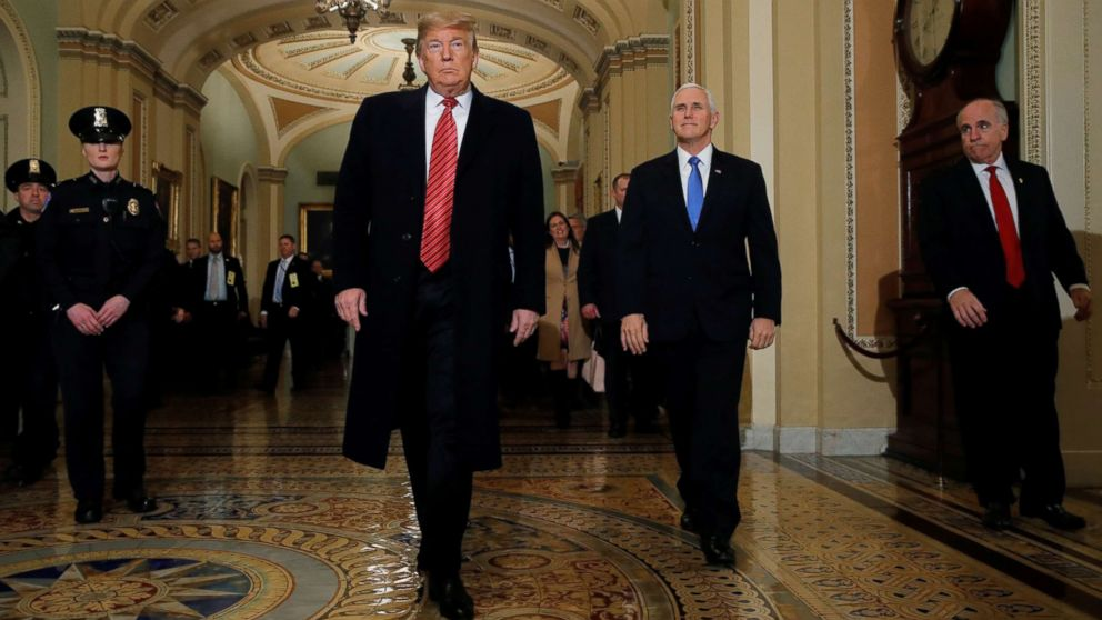President Donald Trump is accompanied by Vice President Mike Pence as they arrives to attend a closed Senate Republican policy lunch as a partial government shutdown entered its 19th day on Capitol Hill in Washington, Jan. 9, 2019.