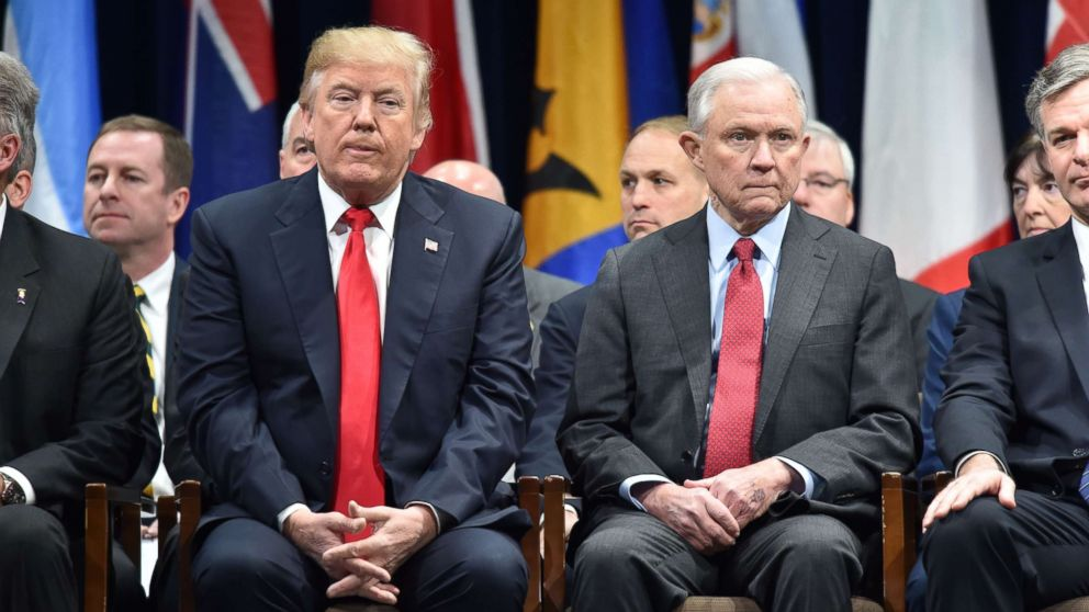President Donald Trump sits with Attorney General Jeff Session, Dec. 15, 2017, in Quantico, Va., before participating in the FBI National Academy graduation ceremony.