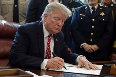 PHOTO: President Donald Trump signs the first veto of his presidency in the Oval Office, March 15, 2019. Trump issued the first veto, overruling Congress to protect his emergency declaration for border wall funding.