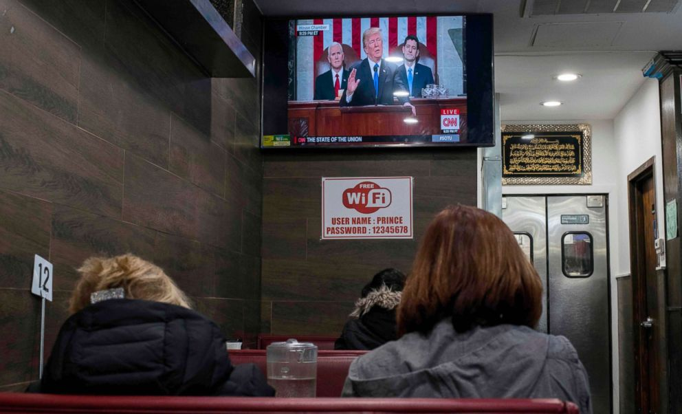 President Donald Trump is shown on a TV, delivering his State of the Union Speech, in a restaurant in New York on Jan. 30, 2018.