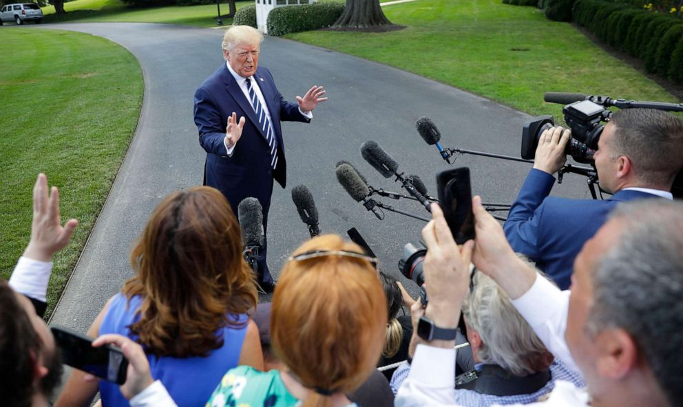 PHOTO: President Donald Trump speaks to members of the media before boarding Marine One helicopter on the South Lawn of the White House in Washington, for the short flight to nearby Andrews Air Force Base, Md., July 19, 2019.