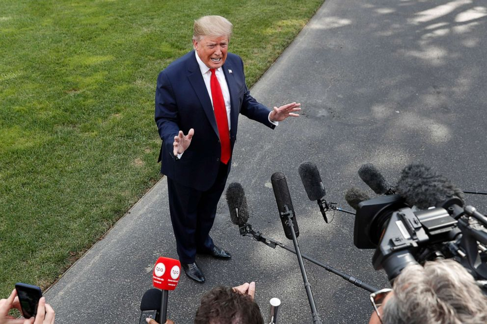 PHOTO: President Donald Trump speaks to the media about the testimony of White House Special Counsel Robert Mueller to Congress, July 24, 2019, outside the White House.